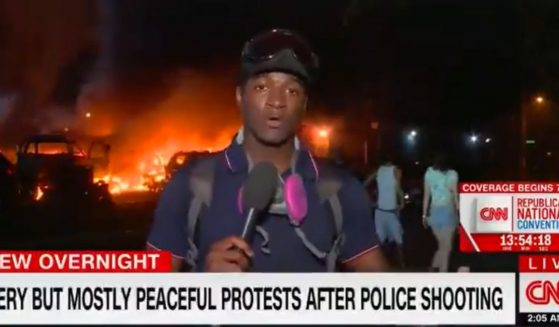 """A chyron on CNN describes the riot in Kenosha, Wisconsin, as """"fiery but mostly peaceful."""""""