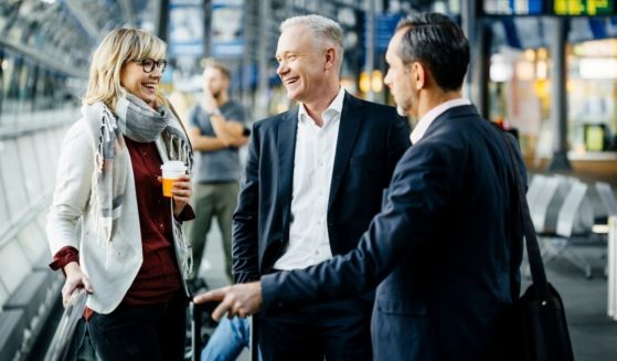 This stock photo portrays a group of people socializing at an airport. With the COVID-19 pandemic nearing its end, how long will the authoritarian regime established last?