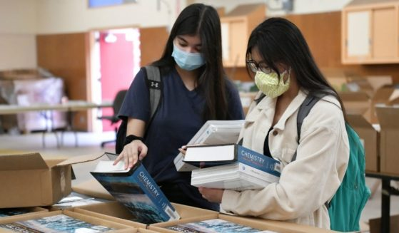 Students pick up their chemistry textbooks at Hollywood High School in Hollywood, California, on Aug. 13.