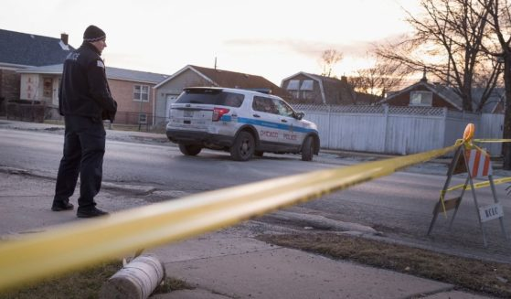 A Chicago police officer guards the perimeter of a crime scene on the city's Southwest Side on Feb. 4, 2016, in Chicago.