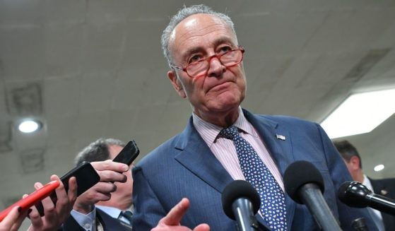 Senate Majority Leader Chuck Shumer is surrounded by media after a closed-door briefing at the U.S. Capitol in Washington, D.C., on May 21, 2019.