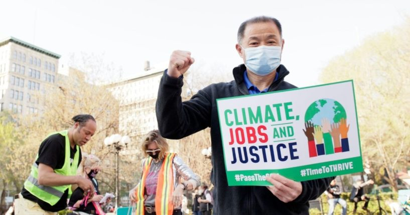 """New York State Democratic Sen. John Liu attends a peaceful protest and gathering to call on Congress to pass the """"THRIVE """"Act plan their route in Union Square on April 7 in New York City."""