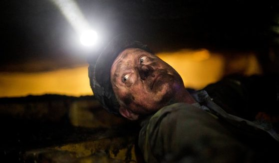 Scott Tiller, a coal miner of 31 years at the time, takes a break while operating a continuous miner machine in a coal mine about 40 inches high in Welch, West Virginia, on Oct. 6, 2015.