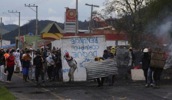 Anti-government protesters clash with police in Gachancipa, Colombia, on Friday.