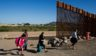 Migrants from Colombia cross the U.S.-Mexico border to turn themselves over to authorities on Thursday in Yuma, Arizona.