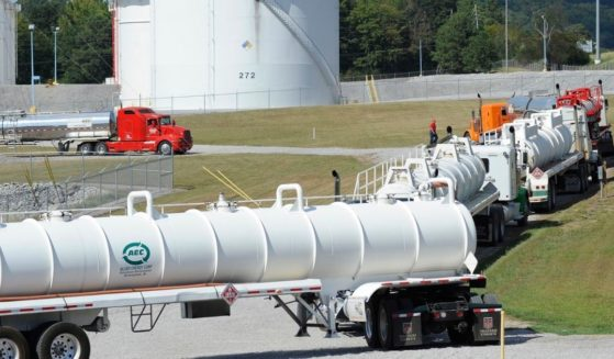 This Sept. 16, 2016, file photo shows tanker trucks lined up at a Colonial Pipeline Co. facility in Pelham, Alabama.