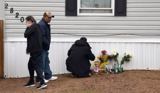 Mourners organize a memorial on Monday outside a mobile home in Colorado Springs, Colorado, where a shooting took place at a party on Sunday.