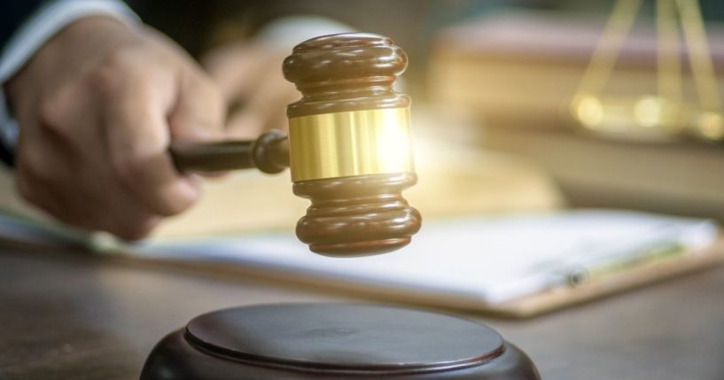 The above stock image shows a judge gavel.