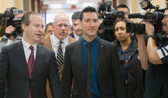 Pro-life journalist David Daleiden, right, arrives with attorney Jared Woodfill, left, and Terry Yates for court on Feb. 4, 2016, in Houston.