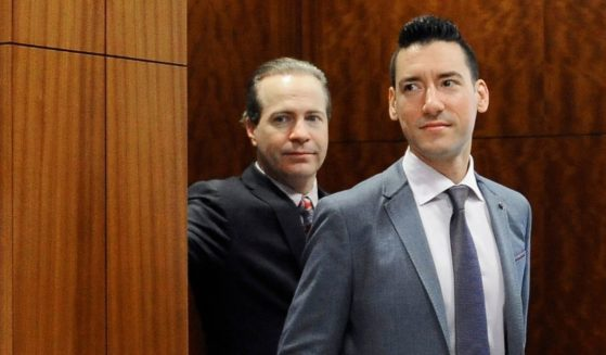 David Robert Daleiden, right, with attorney Jared Woodfill leaves a courtroom after a hearing in Houston on April 29, 2016.