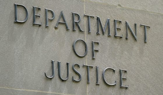 A sign outside the Robert F. Kennedy Department of Justice building in Washington, D.C., is pictured above.