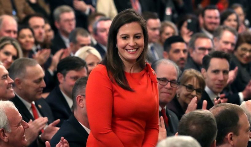 Republican Rep. Elise Stefanik of New York stands as she's acknowledged by then-President Donald Trump as he speaks one day after the Senate acquitted him on two articles of impeachment in the East Room of the White House on Feb. 6, 2020, in Washington, D.C.