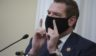Democratic Eric Swalwell of California wears a protective mask while speaking during a House Intelligence Committee hearing on April 15 in Washington, D.C.