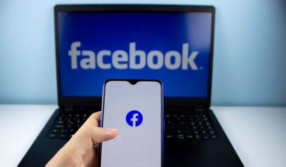 Facebook images are seen on a person's phone and laptop.
