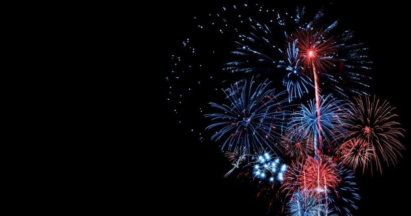 A display of red, white and blue fireworks is pictured above.