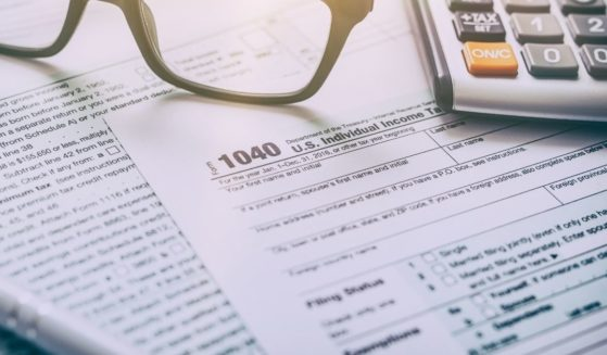 An IRS Form 1040 is pictured in the stock image above.