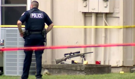 A police officer and a rifle are seen after a shooting Saturday in Fort Smith, Arkansas.