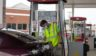 A Wawa gas station attendant wearing a mask pumps gas as the state continues Stage 2 of re-opening following restrictions imposed to slow the spread of coronavirus on Aug. 15, 2020, in Somers Point, New Jersey.
