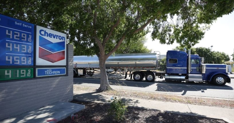 A fuel truck drives by a Chevron gas station on April 29, 2021, in Richmond, California.
