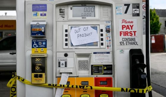 Out of order notes are left on gasoline pumps to let motorists know the pumps are empty at a Shell gas station in Woodbridge, Virginia, on May 12, 2021.