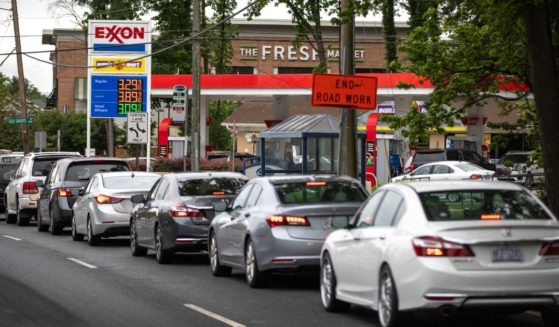 Motorists line up at an Exxon station selling gas at $3.29 per gallon soon after it's fuel supply was replenished in Charlotte, North Carolina, on Wednesday.