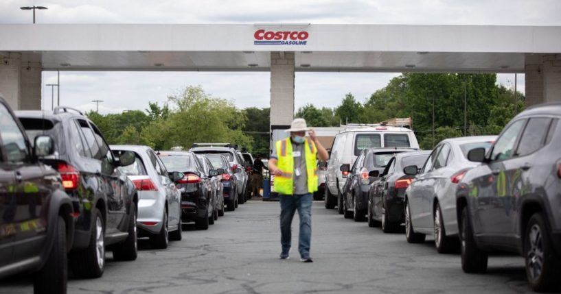 Attendants direct cars as they line up to fill their gas tanks at a Costco on Tyvola Road in Charlotte, North Carolina, on May 11.
