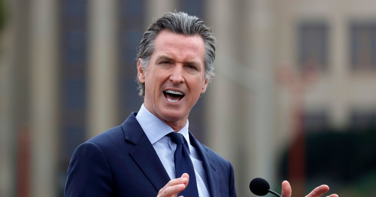 Democratic California Gov. Gavin Newsom speaks during a news conference after touring the vaccination clinic at City College of San Francisco on April 6 in San Francisco.