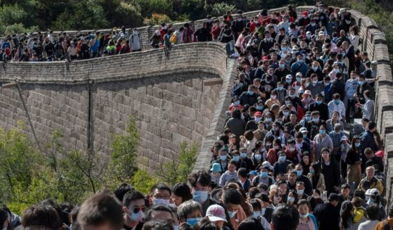 Tourists walk the Great Wall of China