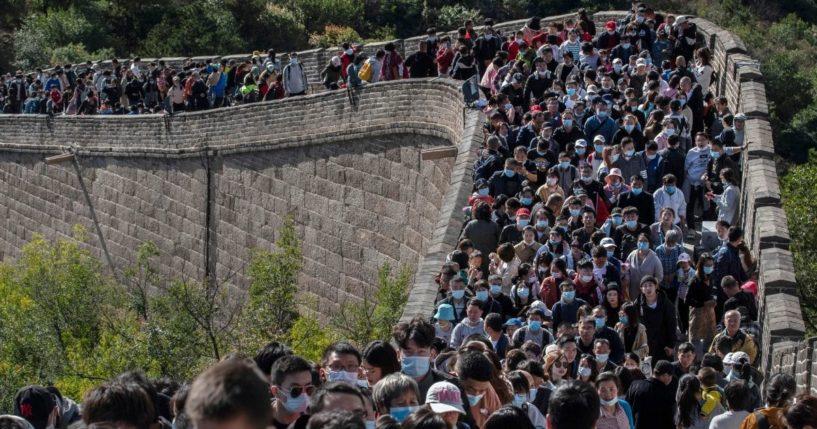 Tourists walk the Great Wall of China