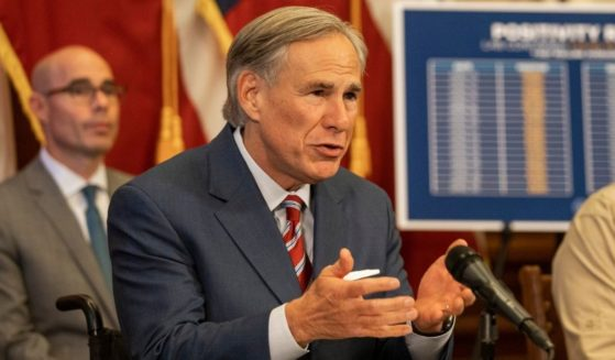 Republican Texas Gov. Greg Abbott announces the reopening of more Texas businesses during the COVID-19 pandemic at a news conference at the Texas State Capitol on May 18, 2020, in Austin, Texas.