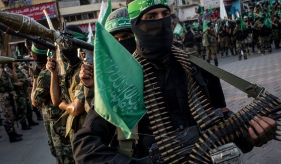 Palestinian Hamas militants are seen during a military show in the Bani Suheila district on July 20, 2017, in Gaza City, Gaza.