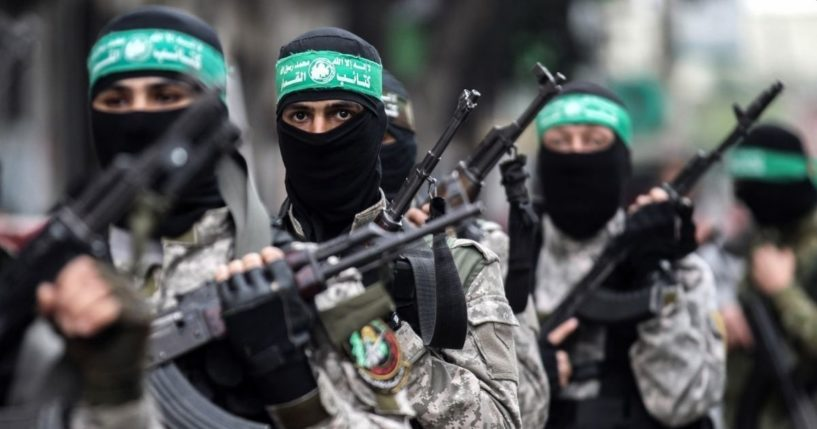 Fighters from the Ezzedine al-Qassam Brigades, the armed wing of the Palestinian Hamas movement, take part in a military show ahead of the 30th anniversary of the movement's founding in the southern Gaza Strip city of Khan Yunis on Dec. 5, 2017.