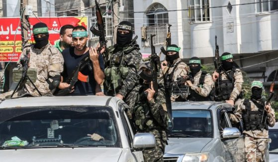 Abdel Halim Badawi, a Palestinian who was held for 18 years in an Israeli prison after he was convicted of being a member of Hamas' armed wing in 2001, rides in the back of a pickup truck with Hamas militants as they celebrate his release in Rafah in the southern Gaza Strip on Oct. 17, 2019.
