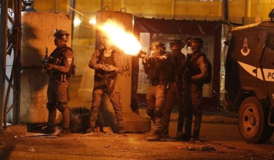 Israel Defense Forces soldiers fire tear gas at Palestinian demonstrators during an anti-Israel protest over tension in Jerusalem, at the Qalandiya checkpoint between Ramallah and Jerusalem in the occupied West Bank on May 11, 2021.