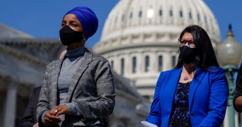 Democratic Reps. Ilhan Omar of Minnesota and Rashida Tlaib of Michigan attend a news conference to discuss proposed legislation outside the U.S. Capitol on March 11, 2021 in Washington, D.C.
