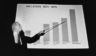 Boston Mayor Kevin White points to a chart showing inflation in different categories on Sept. 25, 1978.