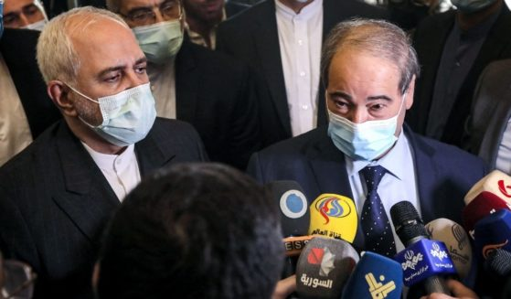 Iran's Foreign Minister Mohammad Javad Zarif, left, and Syria's Foreign Minister Faisal Mekdad, right, speak to reporters after their meeting in Damascus on May 12, 2021.