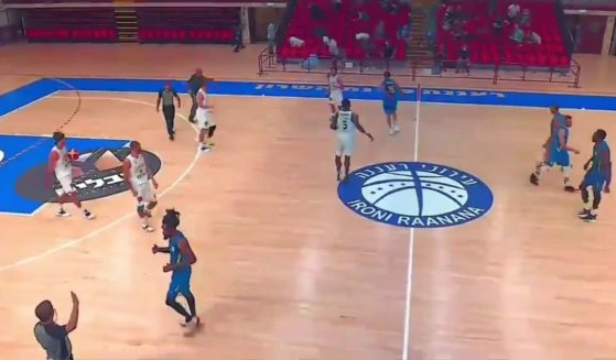 Basketball players in Central Israel were forced to stop their game and drop to the floor on Tuesday, as sirens alerted to incoming air attacks.