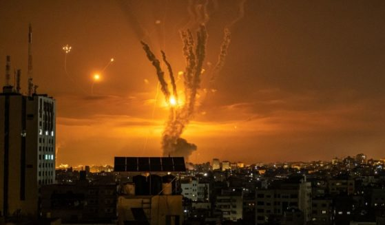 Rockets launched toward Israel from the northern Gaza Strip and response from the Israeli missile defense system known as the Iron Dome leave streaks through the sky on Friday in Gaza City, Gaza.