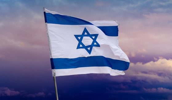 An Israeli flag is pictured in Jerusalem in the stock image above.