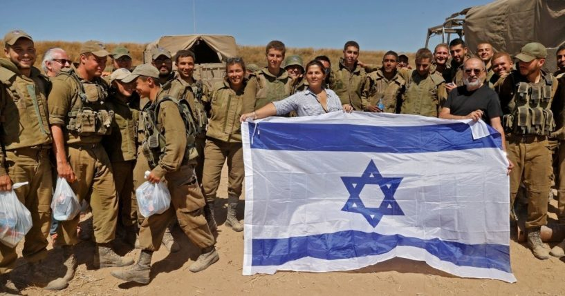 Israelis pose with soldiers along the border in the southern Israeli city of Sderot on Wednesday.