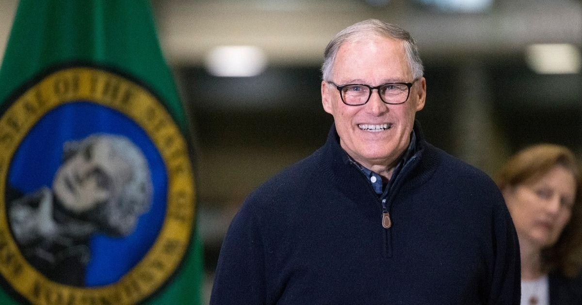 Democratic Washington State Gov. Jay Inslee and other leaders speak to the press on March 28, 2020, in Seattle.