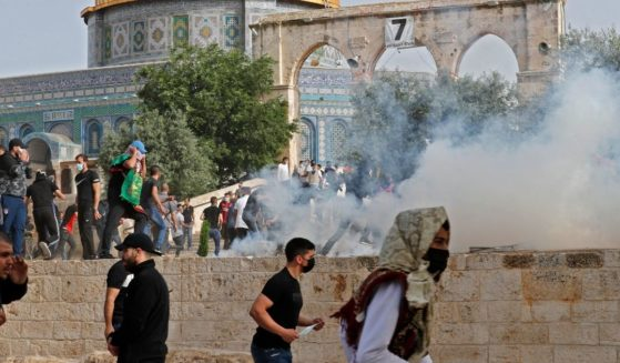 Protesters and rioters are pictured at Jerusalem's Al-Aqsa mosque compound on May 10, 2021.