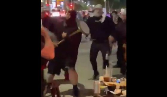Masked men attack Jewish diners in Los Angeles.