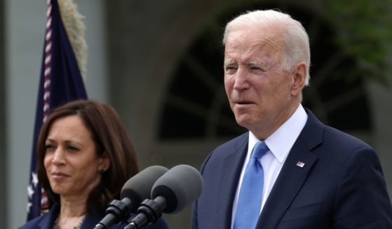 President Joe Biden delivers remarks on the COVID-19 response and vaccination program as Vice President Kamala Harris listens in the Rose Garden of the White House on Thursday in Washington, D.C.