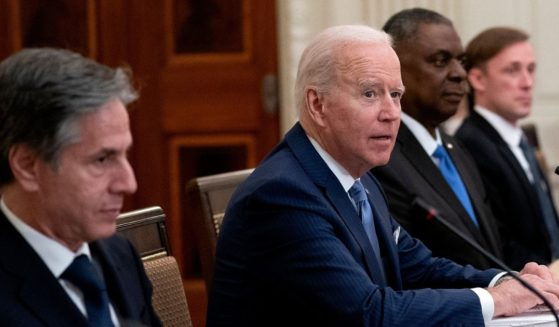 President Joe Biden, flanked by Secretary of State Antony Blinken, left, Secretary of Defense Lloyd Austin, second from right, and National Security Advisor Jake Sullivan, right, meet with South Korean President Moon Jae-in in an expanded bilateral meeting in the State Dining Room of the White House on Friday.