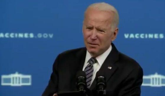Joe Biden speaks above.