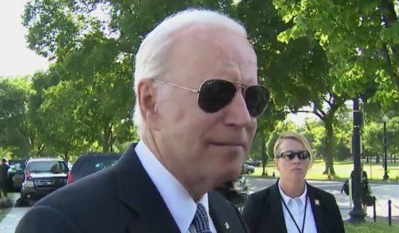 President Joe Biden speaks to reporters outside the White House on Tuesday in Washington, D.C.