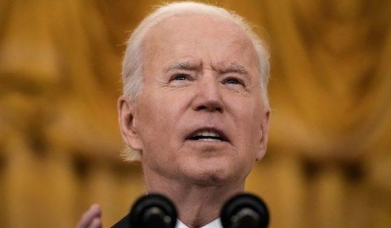 President Joe Biden speaks in the East Room of the White House in Washington on Monday.