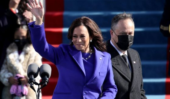 Newly sworn in U.S. Vice President Kamala Harris and her husband Doug Emhoff wave at the inauguration of U.S. President-elect Joe Biden on the West Front of the U.S. Capitol on Jan. 20 in Washington, D.C.